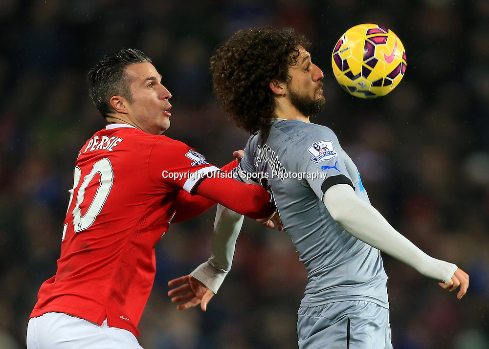 26th December 2014 - Barclays Premier League - Manchester United v Newcastle United - Fabricio Coloccini of Newcastle battles with Robin van Persie of Man Utd - Photo: Simon Stacpoole / Offside.
