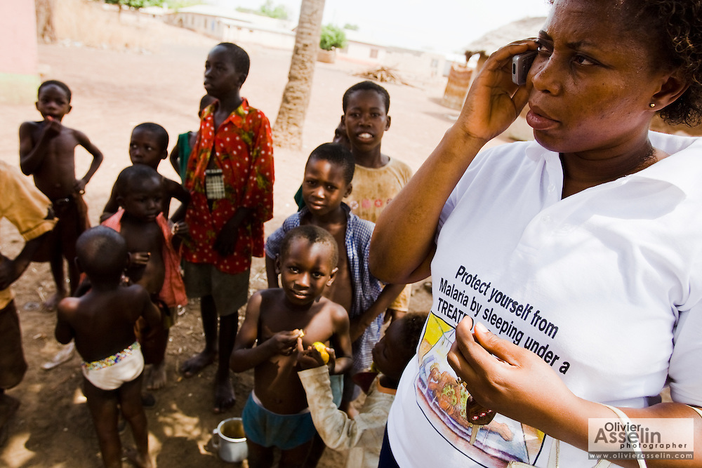 A team supervisor speaks on the phone during a national polio immunization exercise in Salaga, northern Ghana on Thursday March 26, 2009.