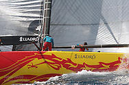 China Team hustles to trim rigging before afternoon of America's Cup fleet racing; Valencia, Spain.