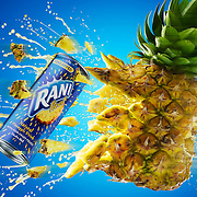 Can of Rani juice exploding out of Pineapple Ray Massey is an established, award winning, UK professional  photographer, shooting creative advertising and editorial images from his stunning studio in a converted church in Camden Town, London NW1. Ray Massey specialises in drinks and liquids, still life and hands, product, gymnastics, special effects (sfx) and location photography. He is particularly known for dynamic high speed action shots of pours, bubbles, splashes and explosions in beers, champagnes, sodas, cocktails and beverages of all descriptions, as well as perfumes, paint, ink, water – even ice! Ray Massey works throughout the world with advertising agencies, designers, design groups, PR companies and directly with clients. He regularly manages the entire creative process, including post-production composition, manipulation and retouching, working with his team of retouchers to produce final images ready for publication.