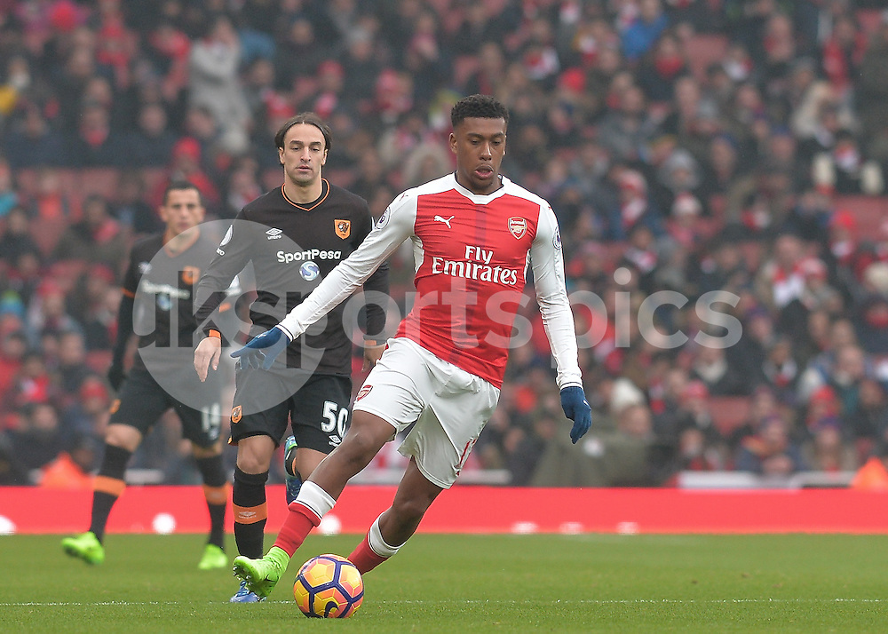 Alex Oxlade-Chamberlain of Arsenal goes past Lazar Markovic of Hull City during the Premier League match between Arsenal and Hull City at the Emirates Stadium, London, England on 11 February 2017. Photo by Vince  Mignott.