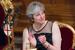 © Licensed to London News Pictures. 13/11/2017. London, UK. British Prime Minister THERESA MAY swears a glucose monitor on her left arm as she attends the annual Lord Mayor's Banquet at Guildhall. Mrs May was diagnosed<br />