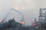 "Israel, Haifa Bay Industrial zone, Firefighters fight a large fire in steel recycling complex ""Chod Matachot"" Near Aco, May 22, 2010, ."