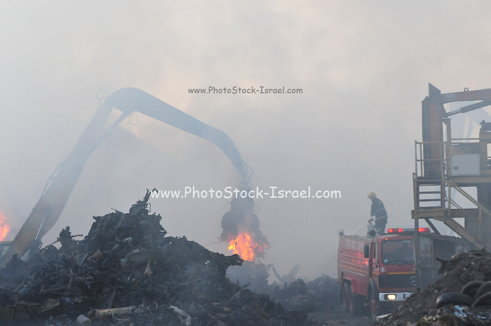 """Israel, Haifa Bay Industrial zone, Firefighters fight a large fire in steel recycling complex """"Chod Matachot"""" Near Aco, May 22, 2010, ."""