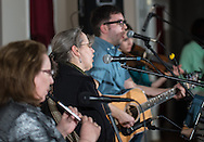 Mindy Murray, center, of The River Drivers, a band from Bristol, sings a song off the band's new CD during the album's release party at Ancient Order of the Hibernian in Bristol, Pa, Saturday, April 4, 2015. Photo by Bryan Woolston.
