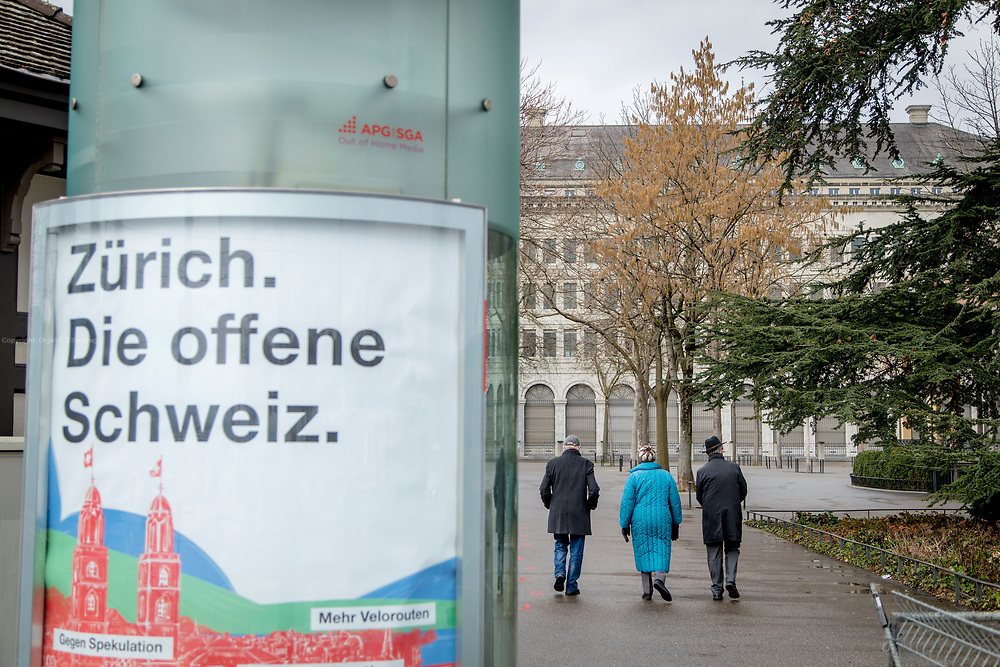 """A poster with the text """"Zürich. The open Switzerland."""" In the background is the Zurich Headquarters of the Swiss National Bank (the bank also have a HQ in Bern). Zurich is by far the biggest city in Switzerland, with a population near 1.83 million in the metropolitan area. It is also the financial center in Switzerland."""
