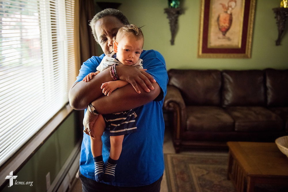 House manager Ronne Murray hugs Ezekiel Vela, son of resident mother Tiffany Busse, at A Place of Refuge on Wednesday, Sept. 2, 2015, in Milwaukee, Wis. LCMS Communications/Erik M. Lunsford