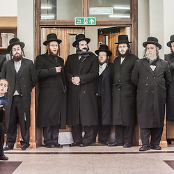 London, UK - 3 December 2014: members of the Jewish community listen to Mr Stephen Williams MP, Parliamentary Under Secretary of State for Communities and Local Government, as he visits the Talmud-Torah Yetev-Lev orthodox Jewish school in Hackney, London