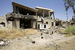 May 24, 2017 - Mosul, Iraq - Scarred Mosul university opened again for classes a week ago despite the extensive destruction the conflict with ISIS has caused it. Here the remains of a bombed out IED factory. Mosul, Iraq, 24 May 2017  (Credit Image: © Noe Falk Nielsen/NurPhoto via ZUMA Press)
