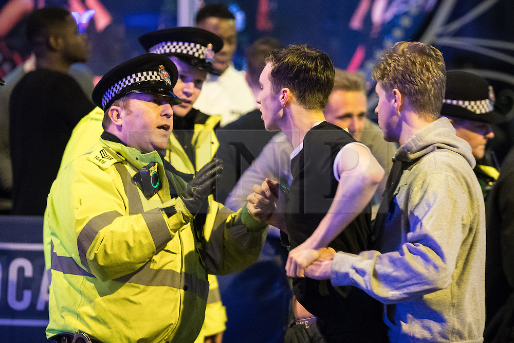 """© Licensed to London News Pictures . 17/12/2016 . Manchester , UK . Police intervene to prevent a fight from escalating , outside The Birdcage on Withy Grove . Revellers out in Manchester City Centre overnight during """" Mad Friday """" , named for being one of the busiest nights of the year for the emergency services in the UK . Photo credit : Joel Goodman/LNP"""