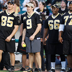 Apr 28, 2010; Metairie, LA, USA; New Orleans Saints players including Drew Brees (9) watch the action during the Heath Evans Foundation charity softball featuring teammates of the Super Bowl XLIV Champion New Orleans Saints at Zephyrs Field.  Mandatory Credit: Derick E. Hingle-US-PRESSWIRE.