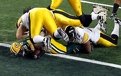 Feb 6, 2011; Arlington, TX, USA; Green Bay Packers safety Nick Collins (36) returns an interception for a touchdown during the first half of Super Bowl XLV against the Pittsburgh Steelers at Cowboys Stadium.  Green Bay defeated Pittsburgh 31-25.