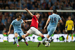 MANCHESTER, ENGLAND - Monday, April 30, 2012: Manchester City's David Silva in action against Manchester United's Phil Jones during the Premiership match at the City of Manchester Stadium. (Pic by Chris Brunskill/Propaganda)