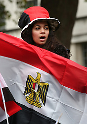 © Licensed to London News Pictures. 05/11/2015. London, UK. A woman carries an Egyptian flag in support of Egyptian President Sisi who is visiting Prime Minister David Cameron. Photo credit: Peter Macdiarmid/LNP