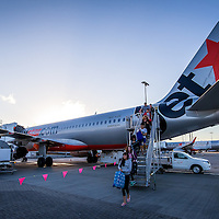 Passengers disembarking Jetstar flight in Cairns
