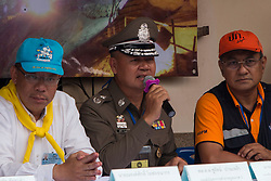 Ploice Major Genral Churat Pangao, deputy commander of police region 5, discusses cave rescue effort during media press conferance at Mae Sai district office staging area