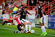 Neal Eardley (23) of Lincoln City is tackled bt Pierce Sweeney (2) of Exeter City during the EFL Sky Bet League 2 match between Exeter City and Lincoln City at St James' Park, Exeter, England on 19 August 2017. Photo by Graham Hunt.