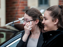 © Licensed to London News Pictures. 25/08/2015. London, UK. A mourner weeps during the funeral of Stephen Lewis, who played Inspector Cyril 'Blakey' in the comedy TV series, On The Buses. He died on Wednesday the 12th of August 2015 aged 88. The funeral was held today, the 25th August 2015 at Our Lady Of Lourdes Church in Wanstead, east London. Photo credit: Pete Maclaine/LNP