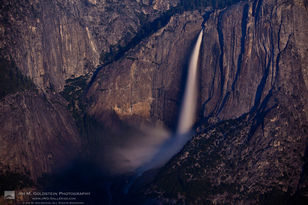 Yosemite Falls lit by a rising full moon, as seen from Glacier Point - Yosemite National Park, California