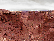 View down a canyon on an overcast day. Along the White Rim Road, Canyonlands National Park, San Juan County, Moab, Utah, USA.