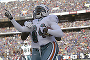 Dolphins wide receiver Chris Chambers (84) celebrates after catching a 23 yard pass for a touchdown and a 7 to 0 lead during a 20 to 3  win by the Miami Dolphins over the Buffalo Bills in an NFL Week 16 game in Buffalo on December 21, 2003. ©Paul Anthony Spinelli
