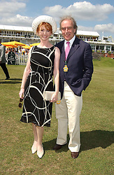 Actress JANE ASHER and her husband MR GERALD SCARFE at the 4th day of the annual Glorious Goodwood horseracing festival held at Goodwood Racecourse, West Sussex on 30th July 2004.