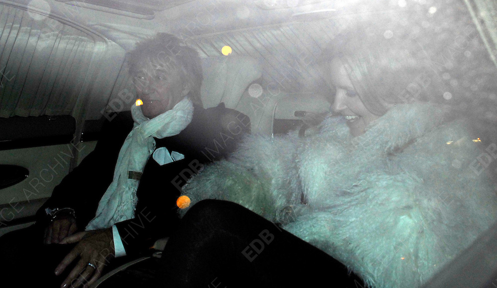 12.DECEMBER.2007. LONDON<br /> <br /> ROD STEWART AND WIFE PENNY LANCASTER LEAVING THE ENGLISH NATIONAL OPERA, LONDON COLISEUM FOR THE PRESS NIGHT FOR NEW SHOW THE SNOW QUEEN.<br /> <br /> BYLINE: EDBIMAGEARCHIVE.CO.UK<br /> <br /> *THIS IMAGE IS STRICTLY FOR UK NEWSPAPERS AND MAGAZINES ONLY*<br /> *FOR WORLD WIDE SALES AND WEB USE PLEASE CONTACT EDBIMAGEARCHIVE - 0208 954 5968*