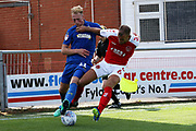 AFC Wimbledon midfielder Mitch Pinnock (11) and Fleetwood Town defender Tommy Spurr (6) during the EFL Sky Bet League 1 match between Fleetwood Town and AFC Wimbledon at the Highbury Stadium, Fleetwood, England on 4 August 2018. Picture by Craig Galloway.