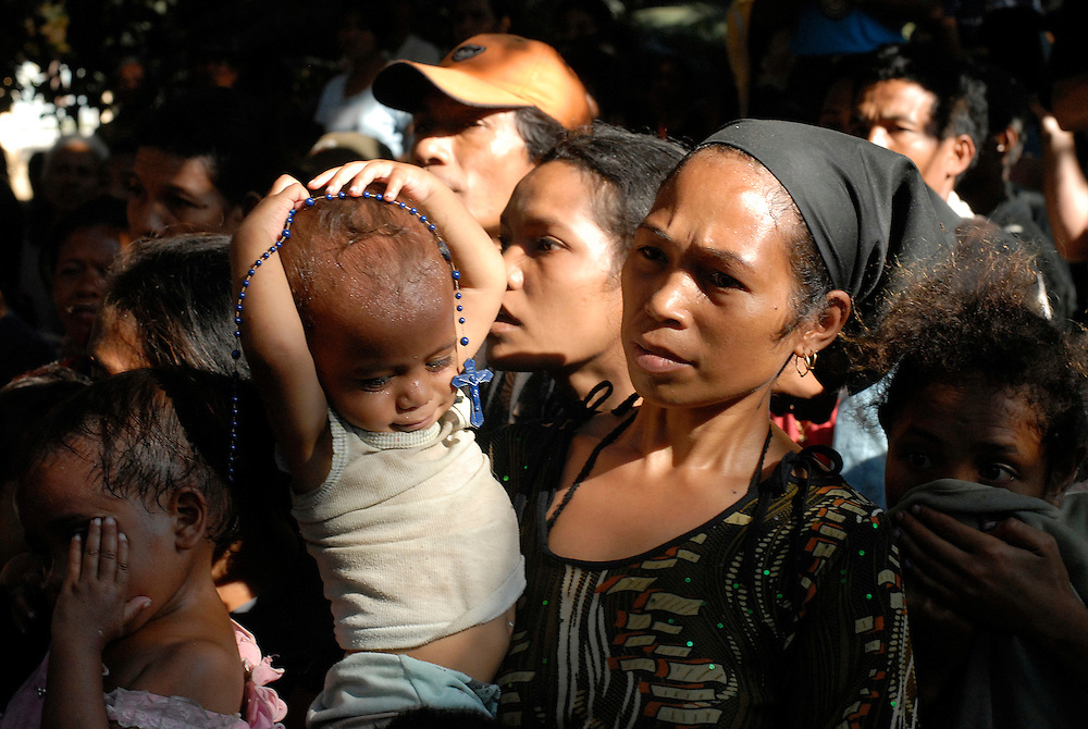 Refugees taking shelter from the violence that erupted in Dili listen to East Timor Foreign Affairs Minister Jose Ramos Horta as he visits the Canossian Sisters and hundreds of internally displaced people at Balide. Dili East Timor 12 June 2006