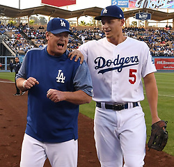 June 10, 2017 - Los Angeles, California, U.S. - Los Angeles Dodgers' Corey Seager (5) shares a laugh with pitching coach Rick Honeycutt prior to a Major League baseball game against the Cincinnati Reds at Dodger Stadium on Saturday, June 10, 2017 in Los Angeles. (Photo by Keith Birmingham, Pasadena Star-News/SCNG) (Credit Image: © San Gabriel Valley Tribune via ZUMA Wire)