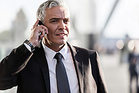 Mature businessman talking on smartphone in airport