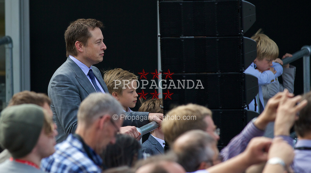 LONDON, ENGLAND - Saturday, June 7, 2014: CEO & Chief Product Architect Elon Musk with one of his sons at the UK launch of Tesla Motors' Model S electric car at the Crystal. (Pic by David Rawcliffe/Propaganda)