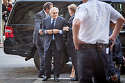 "Former managing director of the IMF, Dominique Strauss-Kahn a.k.a. DSK being escorted to the court to be arrainged in the New York vs. DSK trial. In the trial meeting, Dominique Strauss- Kahn pleaded not guilty in sexually assaulting a 32 year old maid at the Sofitel Hotel in New York. The case was later dismissed due to problems with the maid's credibility, but a settlement was reached outside of court for an undisclosed amount. DSK later admitted to the liaison with the maid as inappropriate and a ""moral fault""."