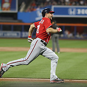 NEW YORK, NEW YORK - July 09: Pitcher Max Scherzer #31 of the Washington Nationals runs home on a Ben Revere #9 of the Washington Nationals triple during the Washington Nationals Vs New York Mets regular season MLB game at Citi Field on July 09, 2016 in New York City. (Photo by Tim Clayton/Corbis via Getty Images)
