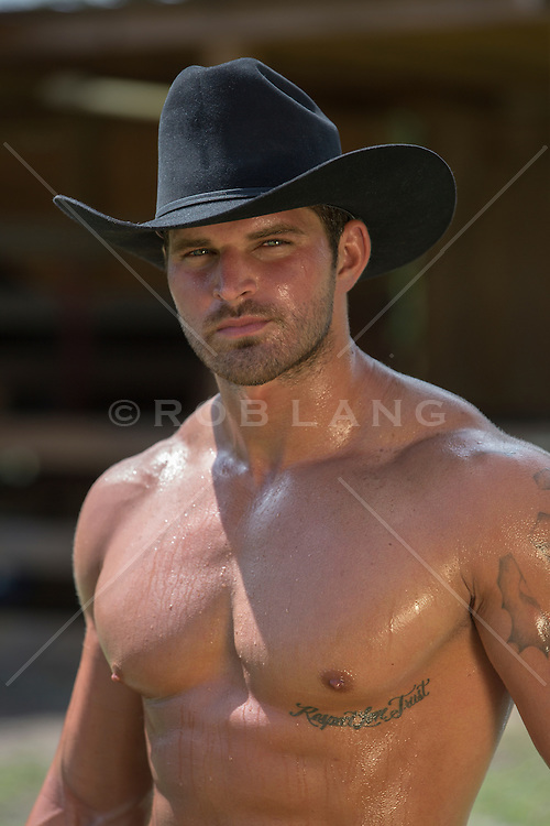 portrait of a sexy shirtless cowboy outdoors