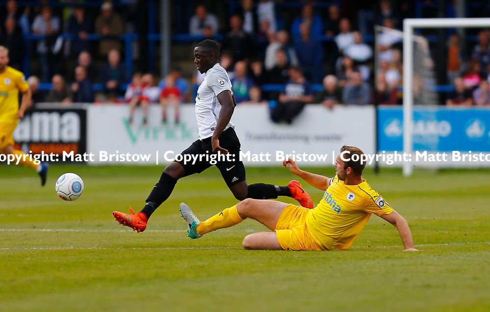 SEPTEMBER 1y6:  Dover Athletic against Chester FC in Conference Premier at Crabble Stadium in Dover, England. Doveer ran out emphatic winners 4 goal to nothing. Dover's midfielder Nortei Nortey steps over a challenge by Chester's John McCombe. (Photo by Matt Bristow/mattbristow.net)