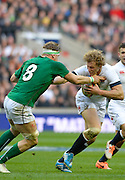 Twickenham Great Britain.  England's,  Billy TWELVETREES, running with the ball, tackled by Jamie HEASLIP, during the 2014 RBS Six Nations Rugby; England vs Ireland. Saturday  22/02/2014  [Mandatory Credit; Peter Spurrier/Intersport-images]