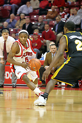 "18 January 2007: Keith ""Boo"" Richardson drives against PJ Couisnard. The Shockers of Wichita State were shut off by the Redbirds by a score of 83-75 at Redbird Arena in Normal Illinois on the campus of Illinois State University."