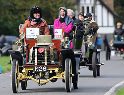 Competitor's make their way through the village of Staplefield, in West Sussex, during the London to Brighton Veteran Car Run, Sunday, 3rd November 2013. Picture by Stephen Lock / i-Images