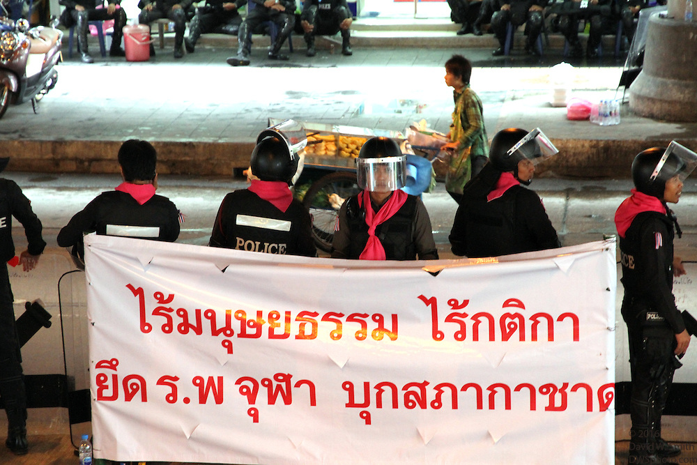 Thai police stand guard during the Red Shirts anti-government protest in the Silom area of Bangkok.