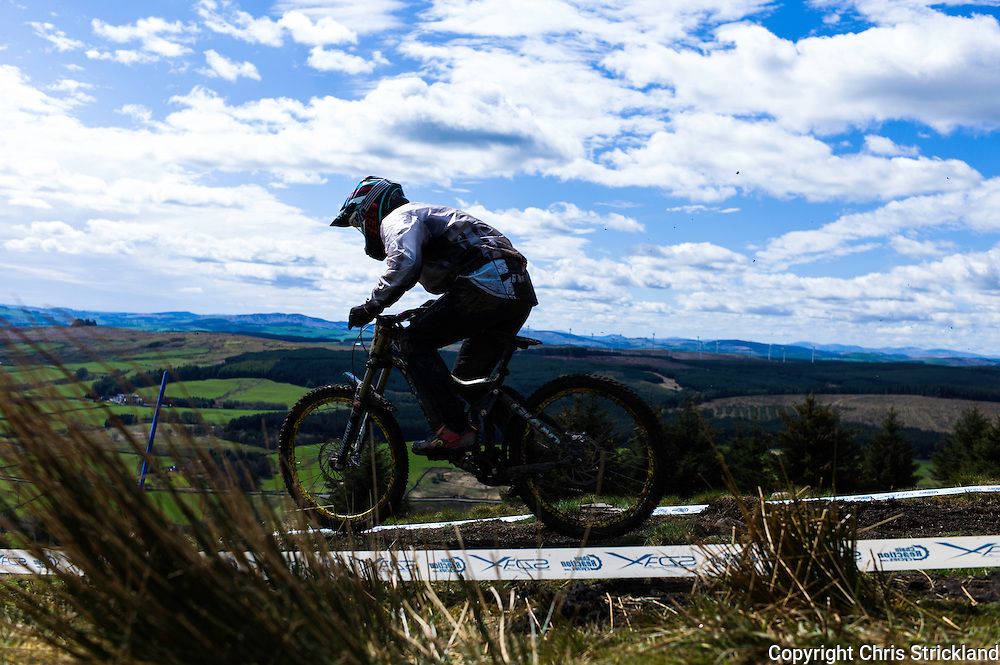 Ae Forest, Dumfries, Scotland, UK. 25th April 2015. A Downhill Mountain Biker leaves the start of the 7Stanes course at Ae during the Scottish Downhill Association racing.