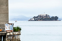 A view of Alcatraz Island on a cloudy morning, a National Historic Landmark in the San Fransisco Bay, San Fransisco, California, USA.