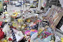 ©  licensed to London News Pictures. LONDON. UK. 07/07/2011 The Shrine of flowers at the murder scene in Upper Wickham Lane Welling continues to grow. Two boys have been remanded in custody today (07/07/11) charged with the murder of a teenager on a busy high street. Yemurai Kanyangarara, 16, was stabbed in the neck seconds after getting off a bus in Welling, south-east London, on Friday.Please see special instructions. Picture credit should read Grant Falvey/LNP