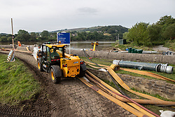 © Licensed to London News Pictures. 03/08/2019. Whaley Bridge, UK. Cement is brought in on pallets to help repair the damage . The town of Whaley Bridge in Derbyshire remains evacuated after heavy rain caused damage to a slipway on the Toddbrook Reservoir , threatening homes and businesses with flooding. Photo credit: Joel Goodman/LNP