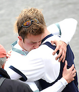 BEN SMITH CAMBRIDGE AND DAVID LIVINGSTONE OXFORD CONSOLE EACH OTHER AFTER ROWING THE 149TH OXFORD CAMBRIDGE BOAT RACE.OXFORD BEAT CAMBRIDGE BY THE SHORTEST OF MARGINS,ONE FOOT.6.4.03.PIX STEVE BUTLER
