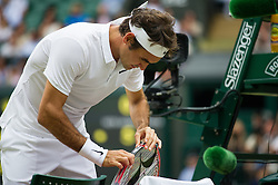 LONDON, ENGLAND - Friday, July 8, 2016:  Roger Federer (SUI) swapping his racquet during the Gentlemen's Singles - Semi-finals match on day twelve of the Wimbledon Lawn Tennis Championships at the All England Lawn Tennis and Croquet Club. (Pic by Kirsten Holst/Propaganda)