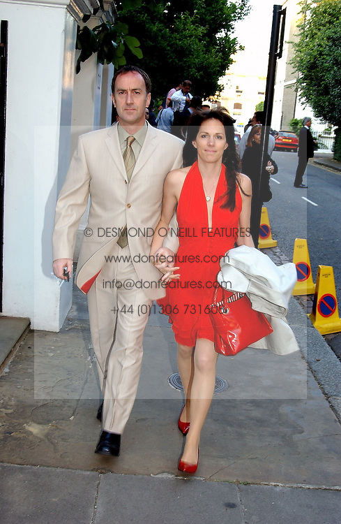 LISE MEYER and ANGUS DEAYTON he is the TV presenter at Sir David & Lady Carina Frost's annual summer party held in Carlyle Square, London on 6th July 2004.