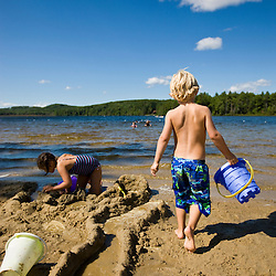 Kids play on the beach at Otter Lake in Greenfield State Park in Greenfield, New Hampshire.