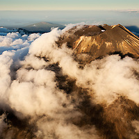 New Zealand, North Island, Tongariro National Park, Aerial view of clouds surrounding summit of Mount Ngaurohoe voclano on summer evening.