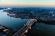 Nederland, Zuid-Holland, Rotterdam, 07-02-2018; Van Brienenoordbrug over de Nieuwe Maas,  rijksweg A16 richting Ridderkerk. Renovatie van de Van Brienenoordbrug, de westelijke boogbrug wordt versterkt want verzwakt door toenemend zwaar verkeer.<br /> Van Brienenoord bridge crossing the New Meuse near Rotterdam.<br /> <br /> luchtfoto (toeslag op standard tarieven);<br /> aerial photo (additional fee required);<br /> copyright foto/photo Siebe Swart